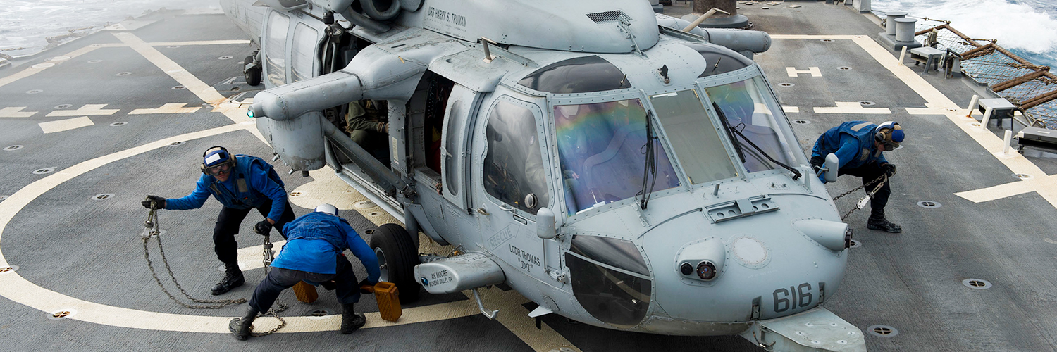 Sailors prepare an MH-60S Sea Hawk helicopter assigned to the Night Dippers of Helicopter Sea Combat Squadron. U.S. Navy photo by Mass Communication Specialist 3rd Class Pasquale Sena/Released.